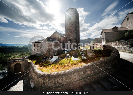 cemetery and church stock photo, Sunset rural landscape with cemetery and church by carloscastilla
