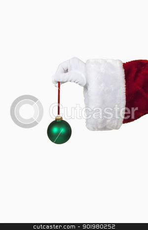 Santa Holding a Christmas Ornament stock photo, Santa holding a christmas ornament, includes clipping path by Bryan Mullennix
