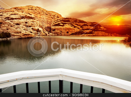 Sunset landscape  stock photo, Sunset landscape with lake and mountains by carloscastilla