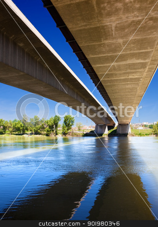 bridge and river stock photo, Close up image of under a bridge with a river by carloscastilla