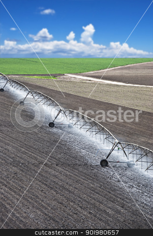 Farm field with irrigation system stock photo, Farm field with modern irrigation system water a newly planted field by tish1