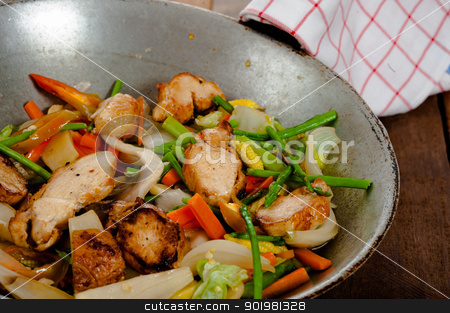 vegetable dish and chicken stock photo, low fat asian vegetable dish with chicken in a wok on wooden table by p.studio66