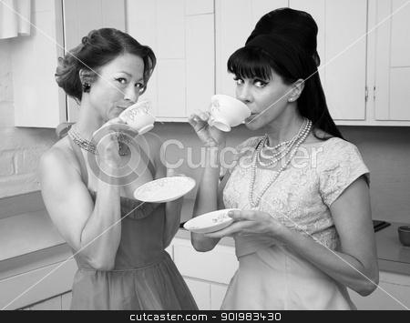 Women Drinking Coffee stock photo, Two retro-styled women drinking coffee in kitchen by Scott Griessel