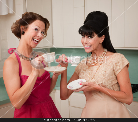 Women Enjoying Coffee stock photo, Two retro style women enjoying tea or coffee in the kitchen by Scott Griessel