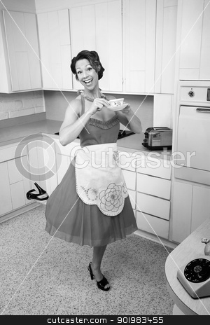 Woman Enjoying Coffee stock photo, Middle-aged Caucasian woman standing on one foot in kitchen by Scott Griessel