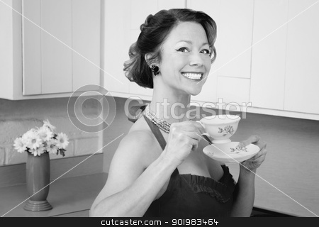 Happy Woman Drinking Coffee stock photo, Happy middle-aged woman drinking coffee in kitchen by Scott Griessel