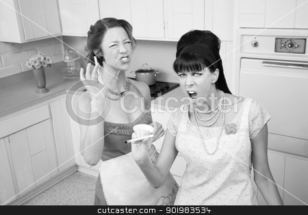 Aggressive Women Smoking stock photo, Two sassy housewives smoking cigarettes in the kitchen  by Scott Griessel