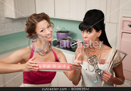 Happy Housewife with Friend stock photo, Happy housewife shows her smoking friend a dish in the kitchen by Scott Griessel