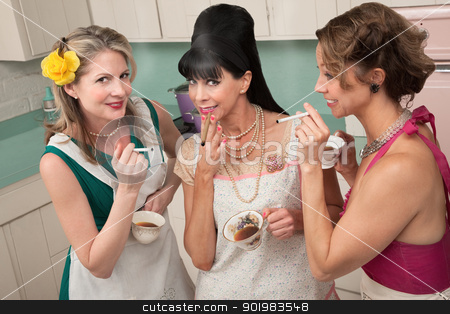 Women Enjoying A Smoke stock photo, Three middle-aged woman smoke in a retro-style tea party by Scott Griessel