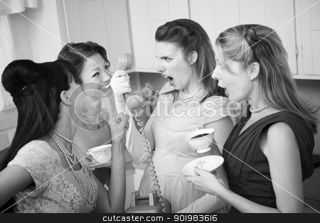 Angry Woman on Phone stock photo, Angry woman on phone with three friends in a kitchen by Scott Griessel