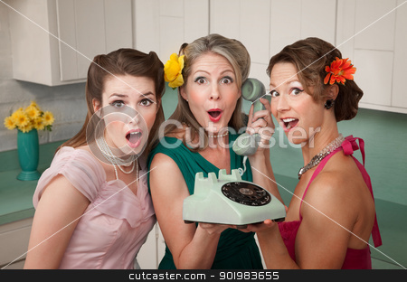 Shocked Women stock photo, Three surprised women holding a rotary telephone in a kitchen by Scott Griessel