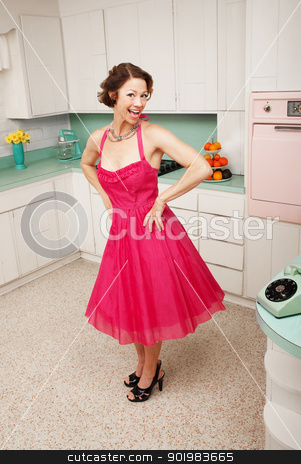 Happy Woman stock photo, Happy middle-aged woman with hands on hips in retro-styled kitchen scene by Scott Griessel