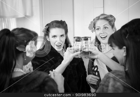 Women Toasting  stock photo, Group of four Caucasian housewives raise a toast in a kitchen by Scott Griessel