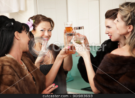 Happy Housewives Drink in the Kitchen stock photo, Group of four Caucasian women in a kitchen make a toast by Scott Griessel