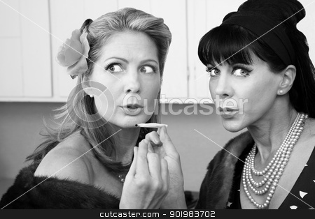 Women Smoking Up Weed stock photo, Sneaky rich housewives share a marijuana joint in kitchen by Scott Griessel