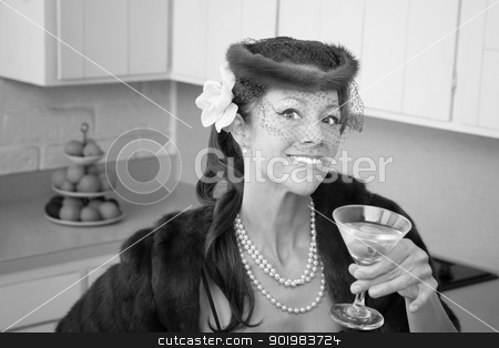 Woman Enjoying Martini stock photo, Caucasian woman wearing veil and mink coat enjoying martini in kitchen  by Scott Griessel