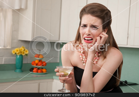 Weeping Woman with a Martini stock photo, Caucasian woman with a martini in her kitchen sobs by Scott Griessel