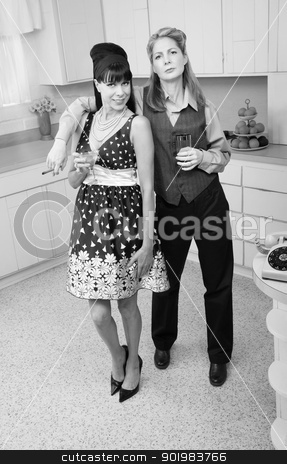 Women Enjoying A Drink stock photo, Lesbian couple with drinks and cigar in kitchen  by Scott Griessel