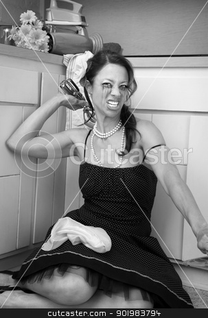 Upset Woman stock photo, Upset woman on kitchen floor throws a hand blender  by Scott Griessel