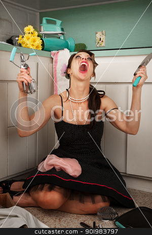 Frustrated Woman Screaming stock photo, Woman screaming in frustration holding hand-blender and masher in kitchen by Scott Griessel
