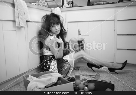 Depressed Woman stock photo, Carefree woman on kitchen floor smokes and drinks by Scott Griessel