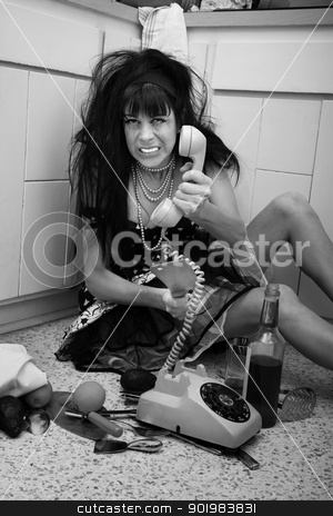 Upset Drunk Women stock photo, Drunk housewife gestures to cut telephone cord with a butcher knife by Scott Griessel
