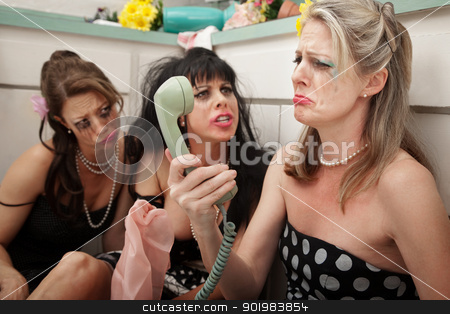Upset Woman With Friends  stock photo, Pouting woman on phone with friends in kitchen by Scott Griessel
