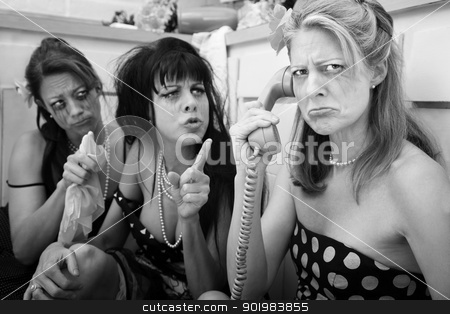 Upset Woman On Phone stock photo, Upset woman with drunk friends on phone in kitchen by Scott Griessel