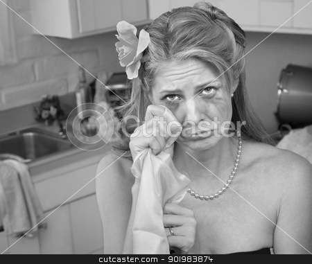 Crying Woman stock photo, Caucasian housewife wipes tears with napkin in her kitchen by Scott Griessel