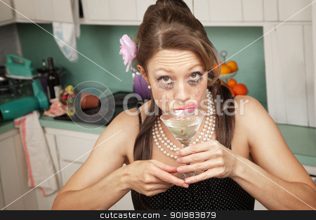 Weeping Woman Has A Drink stock photo, Drunk weeping Caucasian woman in a retro-style kitchen sips a martini  by Scott Griessel
