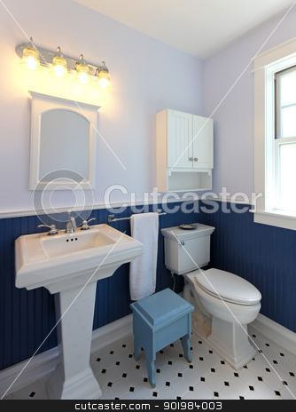 Bathroom with sink and toilet with blue walls. stock photo, Bathroom with sink and toilet with blue walls and tile floor.  by iriana88w