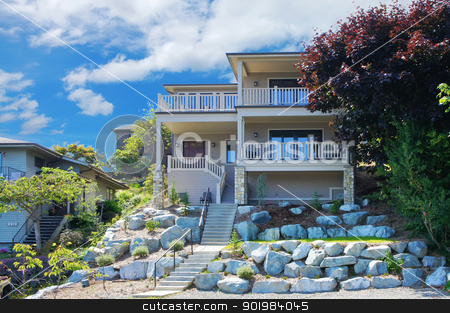 Large house with balconies on the hill with rocks. stock photo, Large house with balconies on the hill with rocks and large trees. by iriana88w