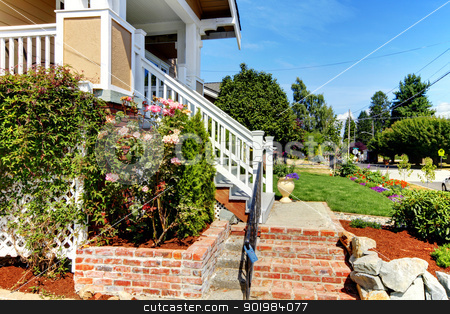 House entrance stairs from brick and roses with the street view. stock photo, Nice house enrance with brick stairs, roses and stree view. by iriana88w