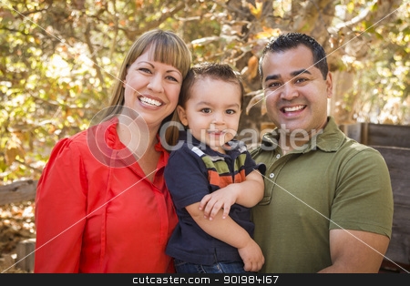Happy Mixed Race Family Posing for A Portrait stock photo, Happy Mixed Race Family Posing for A Portrait in the Park. by Andy Dean