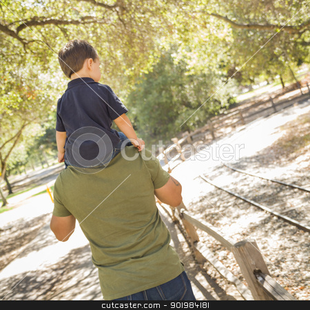 Mixed Race Son Enjoy a Piggy Back in the Park with Dad stock photo, Happy Mixed Race Son Enjoys a Piggy Back Ride in the Park with Dad. by Andy Dean