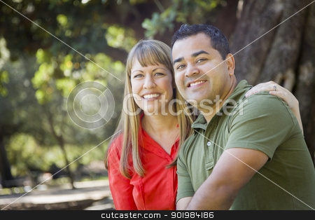 Attractive Mixed Race Couple Portrait at the Park stock photo, Happy Attractive Mixed Race Couple Portrait at the Park by Andy Dean