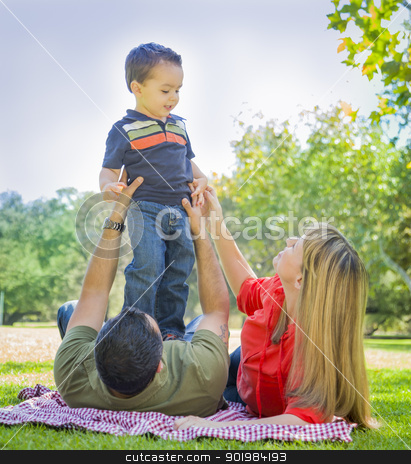 Mixed Race Family Enjoy a Day at The Park stock photo, Happy Mixed Race Family Enjoy a Day at The Park Together. by Andy Dean