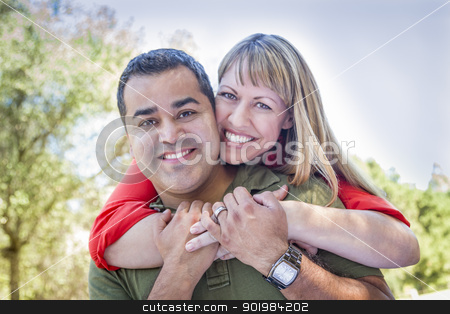 Attractive Mixed Race Couple Piggyback at the Park stock photo, Happy Attractive Mixed Race Couple Piggyback at the Park. by Andy Dean