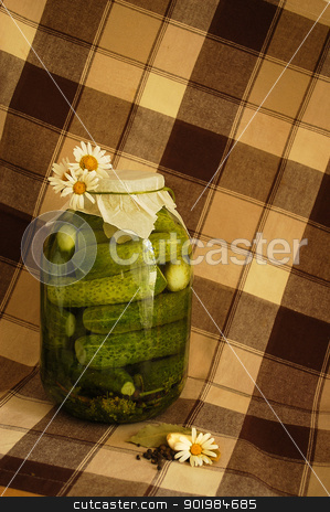 Pickles with daisies stock photo, Pickles decorated with daisies on the plaid coloring tablecloth by Kotkoa