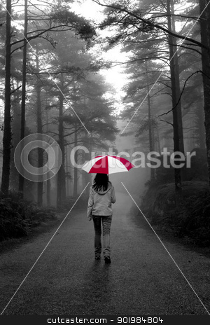 Walking stock photo, Girl walking with an umbrella on a winter rainy day by ikostudio