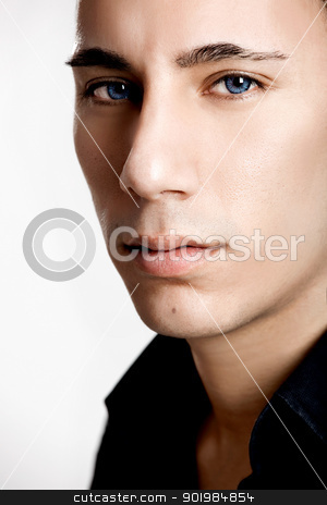 Fashion young man stock photo, Fashion portrait of a young man with blue eyes isolated on white background by ikostudio