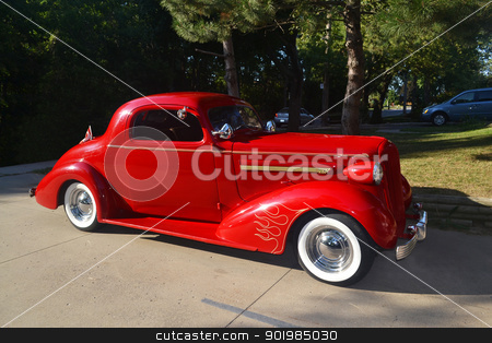 Old 1936 car. stock photo, A beautiful red old car from around 1936, two door Buick with white tire, sitting in a driveway.  by Horst Petzold