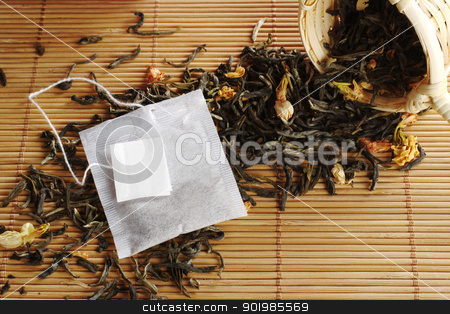 Tea and Teabag stock photo, Teabag with empty white label on lose green tea with dried jasmine blossoms and a wooden tea strainer (Selective Focus, Focus on the teabag and the label) by Ildiko Papp
