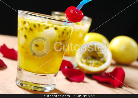 Passion Fruit Juice stock photo, Passion-fruit juice with a drinking straw and a maraschino cherry as well as passion-fruit and rose petals in the background on wooden board (Selective Focus, Focus on the maraschino cherry) by Ildiko Papp