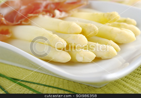 White Asparaus with Ham stock photo, Fresh cooked white asparagus served with ham (Selective Focus, Focus on the front of the asparagus on the left) by Ildiko Papp