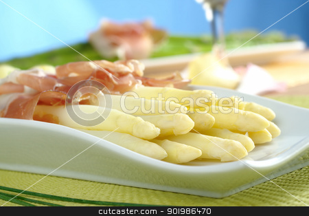 White Asparaus with Ham stock photo, Fresh cooked white asparagus served with ham with white wine and green asparagus in the background (Selective Focus, Focus on the front of the asparagus on the left) by Ildi Papp
