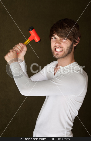 Tough Handy Man With Mallet stock photo, Young angry Caucasian man with mallet clenches his teeth by Scott Griessel