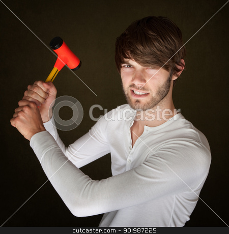 Handy Man With Mallet stock photo, Handsome young bearded man holds up a mallet by Scott Griessel