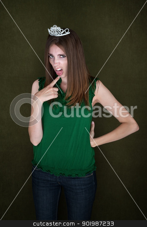 Woman With Tiara and Gag Gesture stock photo, Cute homecoming queen with hand on hip and gagging gesture by Scott Griessel