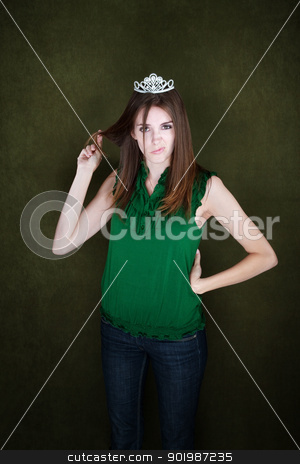 Bored Woman With Tiara stock photo, Bored young woman wearing a tiara twirls her hair by Scott Griessel